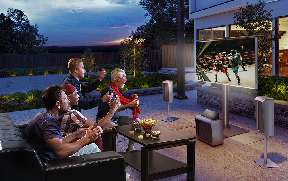 Watch TV outdoor in your backyard.